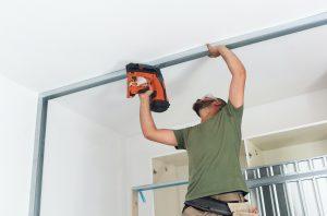 Cerramientos Las Palmas Worker building plasterboard wall.
